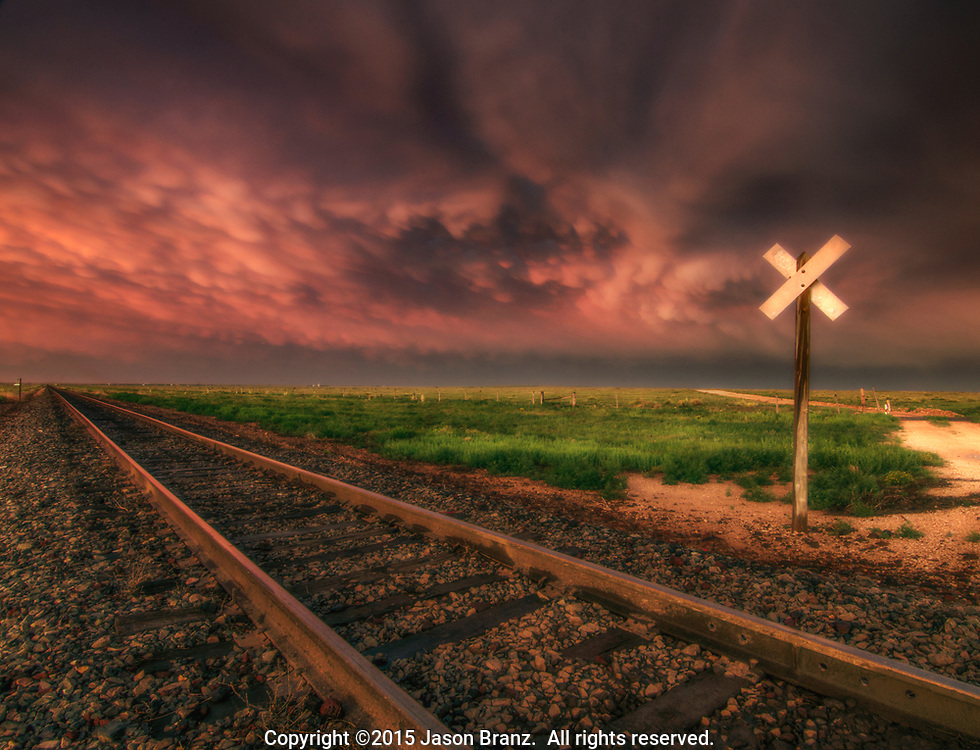Mammatus clouds at sunset over railroad tracks, eastern New Mexico.