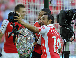 "Arsenal's Santi Cazorla takes a ""selfie
