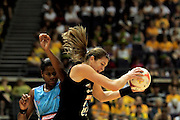 04.07.2011 Irene van Dyk of New Zealand(right) gets ahead of Mere Rabuka to receive a pass during the Pool B match between New Zealand and Fiji, Mission Foods World Netball Championships 2011 from the Singapore Indoor Stadium in Singapore.