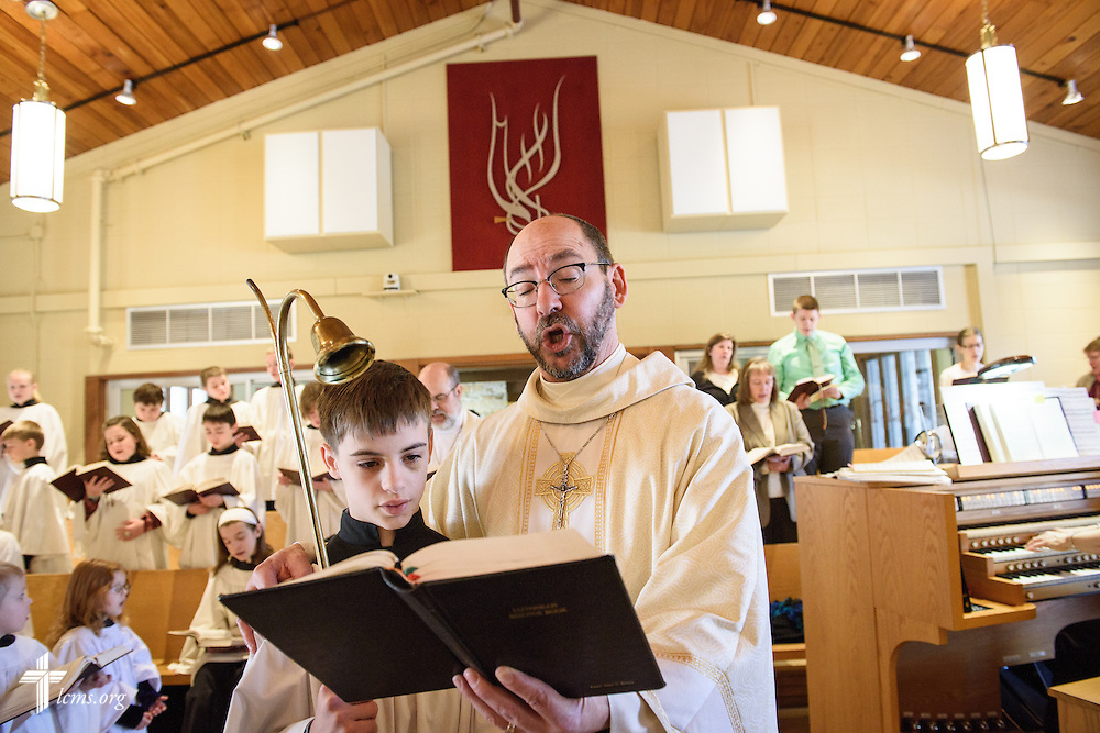 The Rev. Peter Bender, pastor of Peace Lutheran Church in Sussex, Wis., sings the closing hymn on Transfiguration Sunday, Feb. 7, 2016, at the church in Sussex. LCMS Communications/Erik M. Lunsford