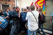 Roma 11 Settembre 2012.I lavoratori della GESIP, multiservizi di Palermo a rischio liquidazione protesta davanti il Parlamento in concomitanza del tavolo di discussione, a cui il sindaco Orlando si presenta con un piano di liquidazione della GESIP a fine 2012, per arrivare alla costituzione di una società consortile partecipata al 51% dal Comune stesso. I manifestanti vengono bloccati dalla polizia .