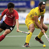 DEN HAAG - Rabobank Hockey World Cup<br /> 34 India - Korea<br /> Foto: Sardar Singh (yellow).<br /> COPYRIGHT FRANK UIJLENBROEK FFU PRESS AGENCY