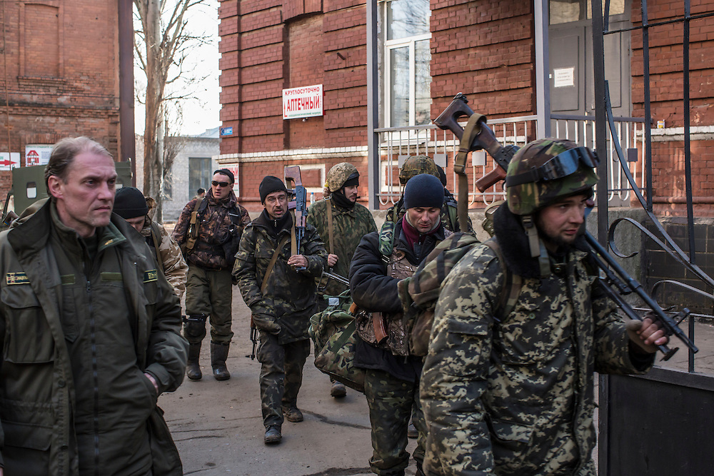 ARTEMIVSK, UKRAINE - FEBRUARY 15: Ukrainian fighters who were able to leave the heavily contested town of Debaltseve arrive from the field on February 15, 2015 in Artemivsk, Ukraine. A ceasefire scheduled to go into effect at midnight was reportedly observed along most of the front, though fighting in Debaltseve continued with Ukrainian forces there effectively surrounded. (Photo by Brendan Hoffman/Getty Images) *** Local Caption ***