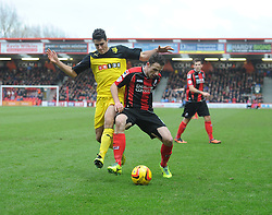 Bournemouth's Marc Pugh battles for the ball with Watford's Mathias Ranegie - Photo mandatory by-line: Alex James/JMP - Tel: Mobile: 07966 386802 18/01/2014 - SPORT - FOOTBALL - Goldsands Stadium - Bournemouth - Bournemouth v Watford - Sky Bet Championship