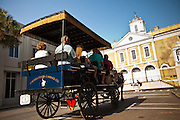 Horse carriage tour passes the Old Exchange Building now called the Provost Dungeon Charleston, SC.