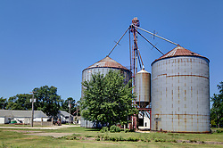 31 July 2015:  Ellsworth Illinois. A grain elevator in a midwest town is needed for trade and to keep the agricultural breadbasket of the world functioning.  They also double as landmarks and help to give small communities identities.  They are often thought of as midwestern skyscrapers as they can define a skyline and are often taller than even a towns water tower.<br /> <br /> <br /> This image was produced in part utilizing High Dynamic Range (HDR) processes.  It should not be used editorially without being listed as an illustration or with a disclaimer.  It may or may not be an accurate representation of the scene as originally photographed and the finished image is the creation of the photographer.