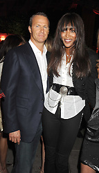 VLADISLAV DORONIN and NAOMI CAMPBELL at the annual Serpentine Gallery Summer Party in Kensington Gardens, London on 9th September 2008.