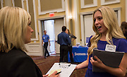 Ohio University student Brittany Hake talks to a representative about job opportunities. Photo by Katelyn Vancouver