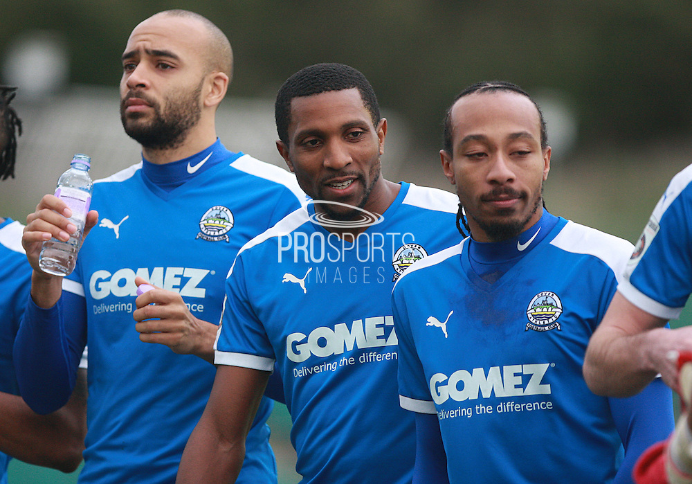 Dover Athletic line up (Richard Orlu, Tyrone Sterling, Ricky Modeste) before kick-off at the FA Trophy match between Whitehawk FC and Dover Athletic at the Enclosed Ground, Whitehawk, United Kingdom on 12 December 2015. Photo by Bennett Dean.