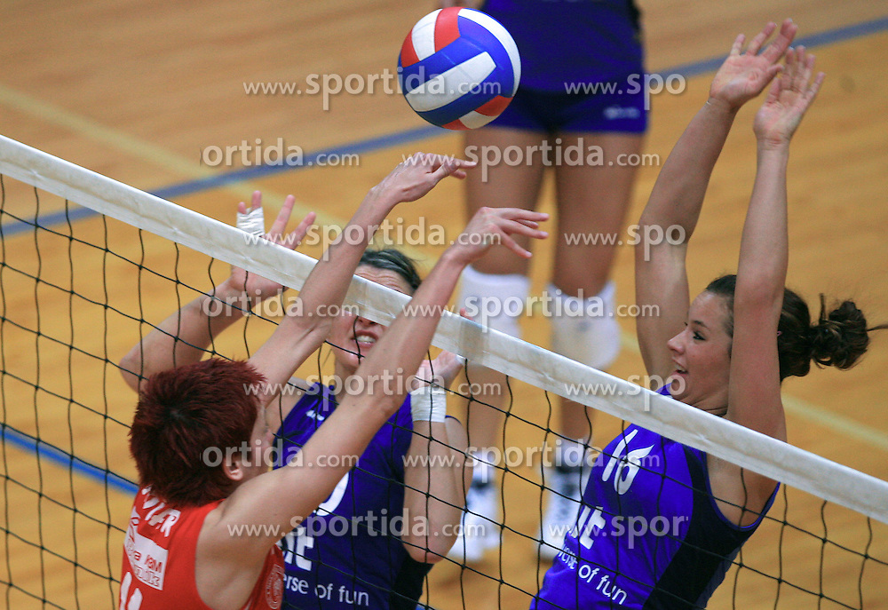 Karmen Kocar of Nova KBM vs Tjasa Testen and Monika Potokar  of Nova Gorica at 1st match of finals of 1st DOL women volleyball league between OK Hit Nova Gorica and OK Nova KBM Branik, Maribor played in OS Milojke Strukelj, on April 8, 2009, in Nova Gorica, Slovenia. Nova KBM Branik won 3:1. (Photo by Vid Ponikvar / Sportida)