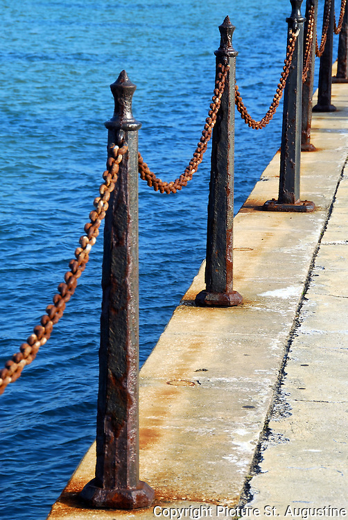 "Stanchions and chains along the seawall on Matanza's Bay in St. Augustine, Florida. This is a different version of a ""Chain Link Fence""."
