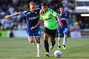 Forest Green Rovers Lloyd James(4) runs forward with Leeds United's Adam Forshaw(4) during the Pre-Season Friendly match between Forest Green Rovers and Leeds United at the New Lawn, Forest Green, United Kingdom on 17 July 2018. Picture by Shane Healey.