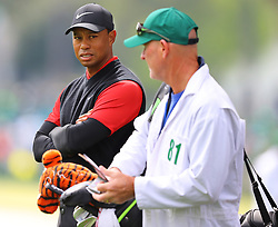 April 8, 2018 - Augusta, GA, USA - Tiger Woods confers with caddy Joe LaCava on the first fairway during the Masters at Augusta National Golf Club on Sunday, April 8, 2018, in Augusta, Ga. (Credit Image: © Curtis Compton/TNS via ZUMA Wire)
