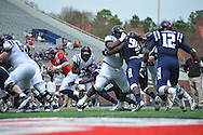 Bo Wallace (14) runs at Mississippi's Grove Bowl controlled scrimmage at Vaught-Hemingway Stadium in Oxford, Miss. on Saturday, April 5, 2014.