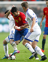 Spain's Diego Costa (c) and Israel's Almog Cohen (l) and David Yair Keltjens during FIFA World Cup 2018 Qualifying Round match. March 24,2017.(ALTERPHOTOS/Acero)