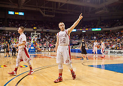 Poca forward Matthew Chandler (22) celebrates beating Westside during a semi-final game at the Charleston Civic Center.