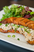 A chicken salad sandwich on a croissant served with a side salad at Meridienne Dessert Salon and Cafe in Rogers, Arkansas.