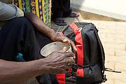 A patients carer sitting outside Mbarara Hospital, Uganda.