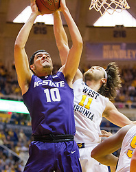 Feb 11, 2017; Morgantown, WV, USA; Kansas State Wildcats forward Isaiah Maurice (10) shoots while defended by West Virginia Mountaineers forward Nathan Adrian (11) during the first half at WVU Coliseum. Mandatory Credit: Ben Queen-USA TODAY Sports