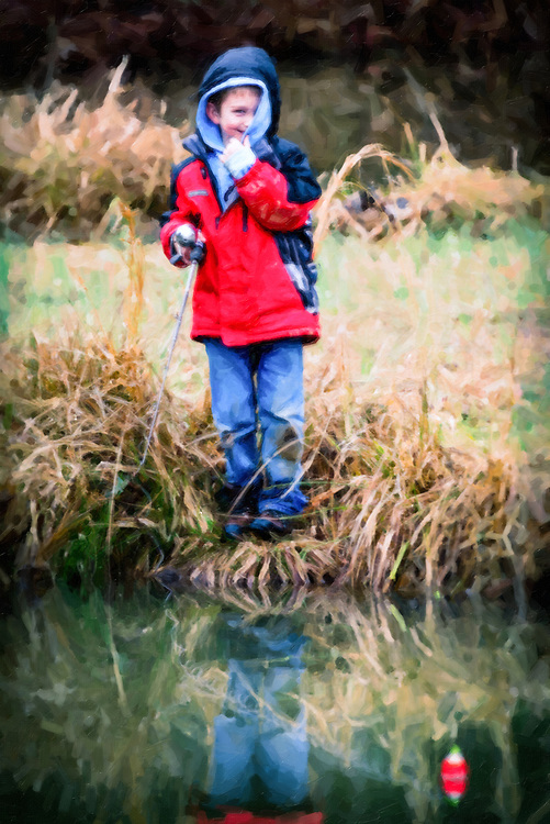 Shy Cub Scout fishing at Woodfield Scout Preservation in Asheboro, NC.