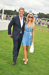 ROB HERSOV and KATIE JAMES at the 25th annual Cartier International Polo held at Guards Polo Club, Great Windsor Park, Berkshire on 26th July 2009.