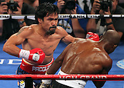 LAS VEGAS, NV - JUNE 09:  (L-R) Manny Pacquiao lands a left to the head of Timothy Bradley during their WBO welterweight title fight at MGM Grand Garden Arena on June 9, 2012 in Las Vegas, Nevada.  (Photo by Jeff Bottari/Getty Images)
