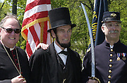 Archbishop Timothy M. Dolan poses for photos with President Abraham Lincoln (played by Robert Rotgers) and Deacon Dean Collins of Mother of Good Counsel Parish. After celebrating a Memorial Day Mass May 26, 2003, at Calvary Cemetery in Milwaukee, the archbishop participated in a tribute staged by Sons of Union Veterans of the Civil War. (Photo by Sam Lucero).