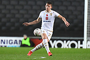 Milton Keynes Dons midfielder Jordan Houghton (24) looks to release the ball during the The FA Cup match between Milton Keynes Dons and Port Vale at stadium:mk, Milton Keynes, England on 9 November 2019.