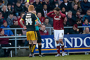 Cambridge United Defender Ryan Haynes gets a yellow card  during the Sky Bet League 2 match between Northampton Town and Cambridge United at Sixfields Stadium, Northampton, England on 12 March 2016. Photo by Dennis Goodwin.