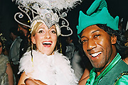 A woman with a large headdress and a man dressed as an elf laugh at Return to Narnia, Pushca, New Years Eve, 2004
