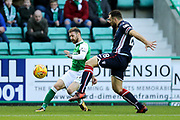 Martin Boyle (#17) of Hibernian sends a cross into the penalty box during the Ladbrokes Scottish Premiership match between Hibernian and Ross County at Easter Road, Edinburgh, Scotland on 23 December 2017. Photo by Craig Doyle.