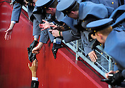 President Barack Obama shakes hands with Army Cadets as he leaves the Army-Navy football game in Landover, Maryland.
