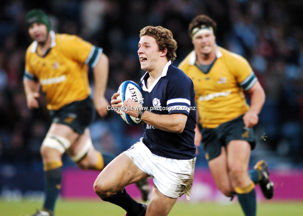 SCOTLAND'S MAN-OF-THE-MATCH CHRIS CUSITER MAKES A SCINTILATING BREAK UP  THE MIDDLE AS THE WALLABIES ARE LEFT    TO CHASE<br />SCOTLAND V AUSTRALIA, HAMPDEN PARK, SATURDAY 20TH NOVEMBER 2004<br />COPYRIGHT: FOTOSPORT/DAVID GIBSON/PHOTOSPORT