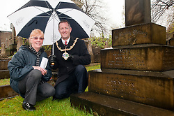 Janet Worrall Secretary of the the Friends of Boston Castle Parkland and Mooregate Cemetery shows the current mayor of Rotherham, Cllr Shaun Wright, John Masons's grave. The Jeweler and former Mayor of Rotherham designed the chain of office worn by Rotherham Mayors...120627 Mayor tours Mooregate Cemetery..http://www.pauldaviddrabble.co.uk.18 April 2012 .Image © Paul David Drabble