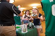 Left to right, Pauline Lisciotto, James Lisciotto, and Dona Lisciotto sign up for an O zone student section membership during Bobcat Student Orientation on June 14, 2016. © Ohio University / Photo by Kaitlin Owens
