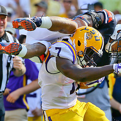 Sep 19, 2015; Baton Rouge, LA, USA; LSU Tigers running back Leonard Fournette (7) breaks a tackle by Auburn Tigers defensive back Tray Matthews (28) on a touchdown run during the third quarter of a game at Tiger Stadium. Mandatory Credit: Derick E. Hingle-USA TODAY Sports