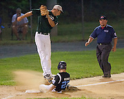 Pennsylvania's Matt Klimas steals third base as West Deptford's Bobby McSorley has to jump to grab the throw during the opening round of the Mid-Atlantic Senior League regional tournament held in West Deptford on Friday, August 5.