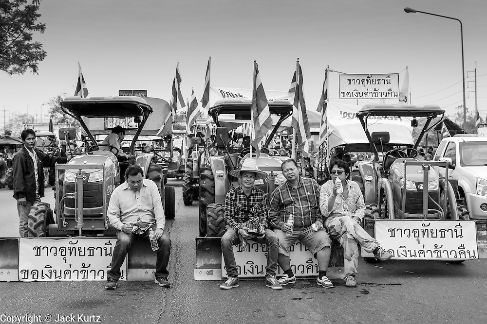 21 FEBRUARY 2014 - KHLONG CHIK, PHRA NAKHON SI AYUTTHAYA, THAILAND:  Thai farmers on the highway south of Ayutthaya. About 10,000 Thai rice farmers, traveling in nearly 1,000 tractors and farm vehicles, blocked Highway 32 near Bang Pa In in Phra Nakhon Si Ayutthaya province. The farmers were traveling to the airport in Bangkok to protest against the government because they haven't been paid for rice the government bought from them last year. The farmers turned around and went home after they met with government officials who promised to pay the farmers next week. This is the latest blow to the government of Yingluck Shinawatra which is confronting protests led by anti-government groups, legal challenges from the anti-corruption commission and expanding protests from farmers who haven't been paid for rice the government bought.   PHOTO BY JACK KURTZ