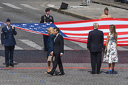 L-R : French President Emmanuel Macron and wife Brigitte Macron, US President Donald Trump and First Lady Melania Trump attend Bastille Day Military Parade, Place de la Concorde, in Paris on July 14, 2017. Photo by Ammar Abd Rabbo/ABACAPRESS.COM