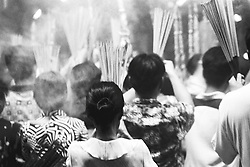 Vietnam, Ho Chi Minh City, 2002. The week-long Tet New Year festival is celebrated all over Vietnam. Near Cholon, Buddhists gather to burn heady clouds of incense.