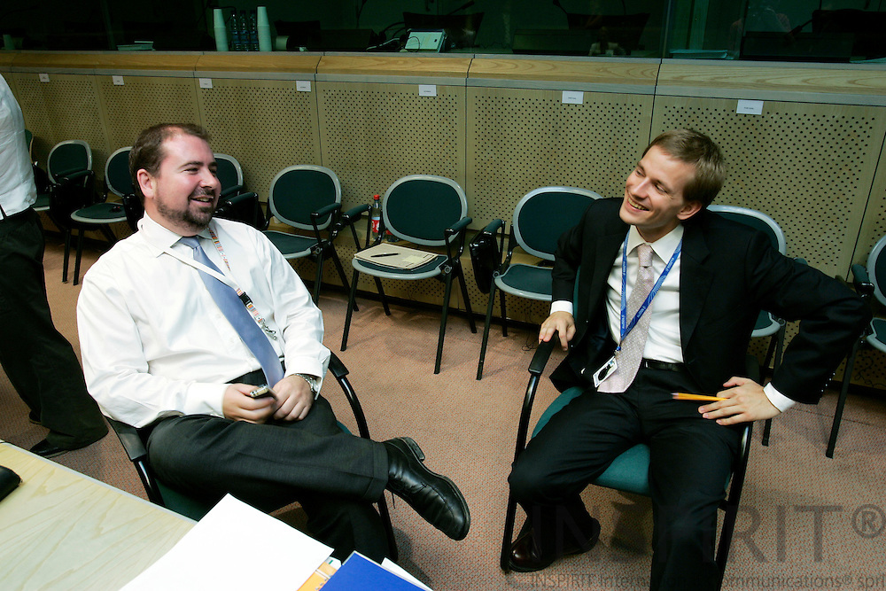 BRUSSELS - BELGIUM - 28 JULY 2006 -- Lauri VOIONMAA, Attache Foreign Relation Counsellors, the Permanent Representation of Finland to the EU speaking with his Irish counterpart Kyle Michael O'SULLIVAN at the RELEX-meeting in the EU Council. -- PHOTO: ERIK LUNTANG / ..