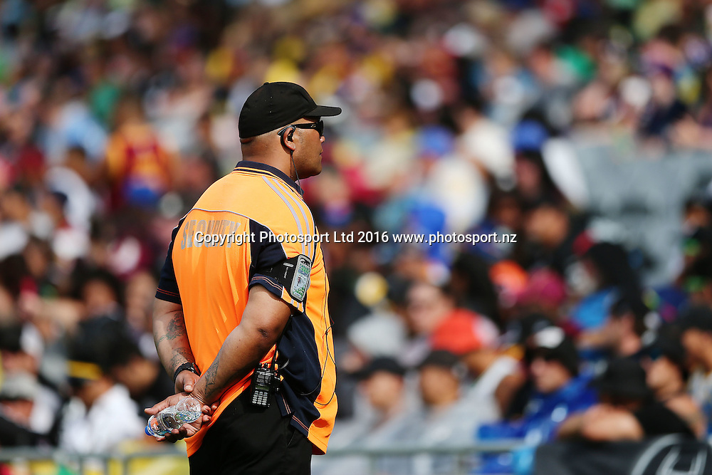 A security guard keeps his eyes on the crowds during Day 1 of the NRL Auckland Nines Rugby League Tournament, Eden Park, Auckland, New Zealand. Saturday 6 February 2016. Photo: Anthony Au-Yeung / www.photosport.nz