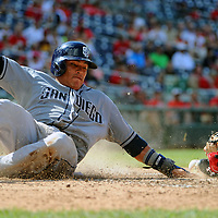 07 July 2013:  San Diego Padres shortstop Everth Cabrera (2) scores in action against Washington Nationals catcher Wilson Ramos (40) at Nationals Park in Washington, D.C. where the Washington Nationals defeated the San Diego Padres, 11-7 to sweep the series.