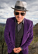 Quincy, WA - MAY 26: Elvis Costello poses for a portrait backstage at the Gorge Amphitheater on May 26, 2013 in Quincy, Washington. (Photo by Steven Dewall/Redferns via Getty Images)