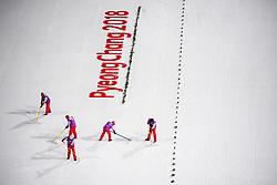February 12, 2018 - Pyeongchang, SOUTH KOREA - 180212 Stewards preparing the landing prior the Women's Normal Hill Individual Final, during day three of the 2018 Winter Olympics on February 12, 2018 in Pyeongchang..Photo: Joel Marklund / BILDBYRÃ…N / kod JM / 87619 (Credit Image: © Joel Marklund/Bildbyran via ZUMA Press)