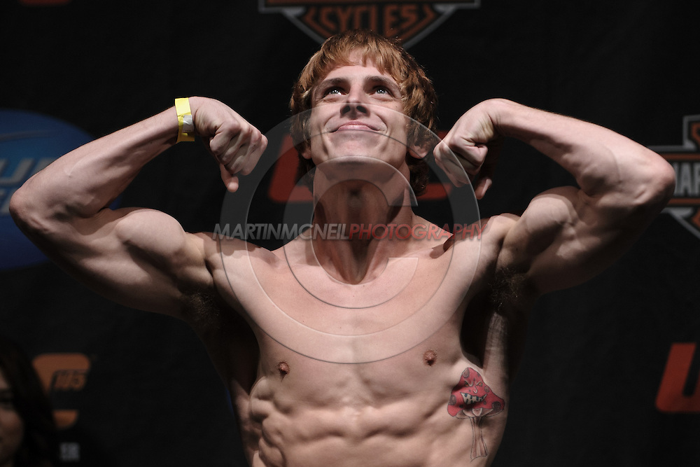 MANCHESTER, ENGLAND, NOVEMBER 13, 2009: Matthew Riddle poses on the scales during the weigh-ins for UFC 105 at the MEN Arena in Manchester, England on November 13, 2009.