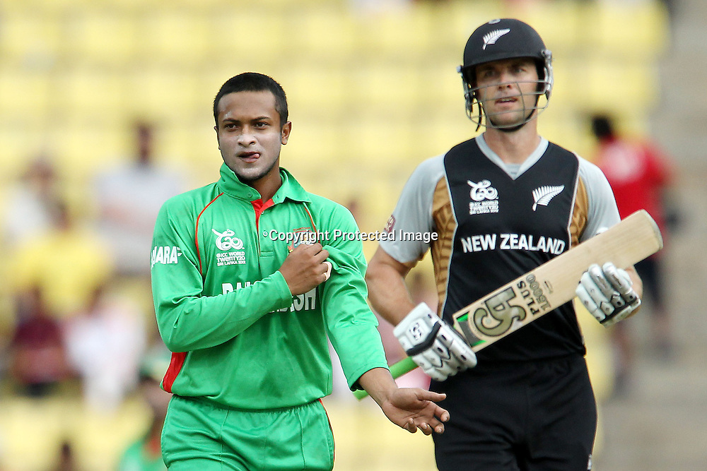 Shakib Al Hassan reacts after James Franklin knocks him for four during the ICC World Twenty20 Pool match between New Zealand and Bangladesh held at the  Pallekele Stadium in Kandy, Sri Lanka on the 21st September 2012<br /> <br /> Photo byRon Gaunt/SPORTZPICS/PHOTOSPORT