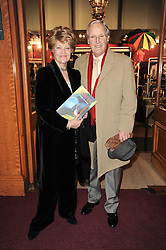 TV presenter NICHOLAS PARSONS and his wife ANNE at the gala opening night of Cirque du Soleil's Varekai at the Royal Albert Hall, London on 5th January 2010.