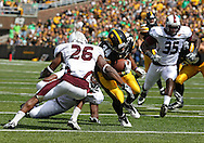 September 24, 2011: Iowa Hawkeyes running back Marcus Coker (34) is hit by Louisiana Monroe Warhawks cornerback Nate Brown (26) on a run during the second quarter of the game between the Iowa Hawkeyes and the Louisiana Monroe Warhawks at Kinnick Stadium in Iowa City, Iowa on Saturday, September 24, 2011. Iowa defeated Louisiana Monroe 45-17.