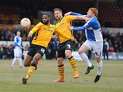 Rory Gaffney of Bristol Rovers Battles for the ball with Janoi Donacien of Newport County - Mandatory byline: Alex James/JMP - 19/03/2016 - FOOTBALL - Rodney Parade - Newport, England - Newport County v Bristol Rovers - Sky Bet League Two